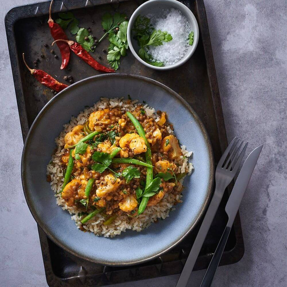 Vegan Cauliflower And Lentil Red Curry With Brown Rice